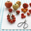 Stock Photo: Assorted tomatoes on table