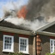Stock Photo: House roof on fire