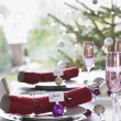 Stock Photo: Christmas crackers with name tags
