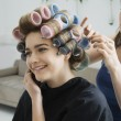 Hairstylist Rolling Hair of Model — Stock Photo #33889205