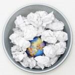 Waste bin with globe — Stock Photo #33889275