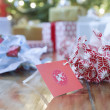 Stock Photo: Gifts, unwrapped paper and gift tag