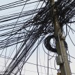 Tangle of Electrical Wires on Power Pole — Stock Photo #33889453
