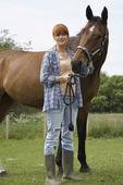 Woman Petting Horse — Stockfoto