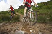 Mountainbikers on a Muddy Trail — Stock Photo