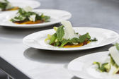 Plates of salad with grated cheese — Stock Photo