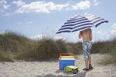 Boy on beach under umbrella — Stock Photo