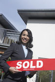 Agent Holding Sold Sign — Stock Photo