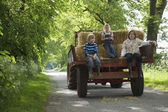 Children on Tractor Trailer — Stock Photo
