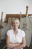 Artist standing by artwork — Stock Photo