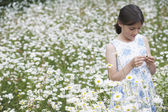 Girl in Wildflower Meadow — Stock Photo