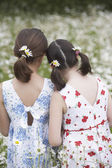 Two Girls in Wildflower Meadow — Stock Photo
