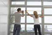 Couple Measuring Windows — Stock Photo