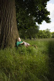 Woman Sitting Beneath a Tree — Stock Photo