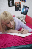 Girl writing diary — Stock Photo