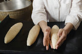 Baker Shaping Loaves of Bread Dough — Stock Photo