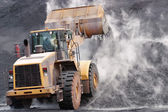 Front loader dumping mineral material — Stock Photo