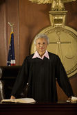 Judge standing in court — Stock Photo