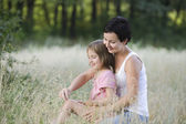 Mother and Daughter in a Field — Stock Photo