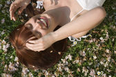Woman Lying in Grass — Stock Photo