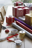 Christmas gifts, wrapping paper and accessories — Stock Photo