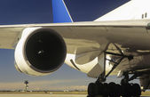 Man inspecting engine of passenger jet — Stock Photo