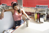 Woman Relaxing in a Diner Booth — Stock Photo