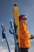 Woman by ski and ski poles — Stock Photo