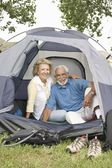Couple at entrance to tent — Stock Photo