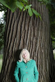 Woman Standing Beneath a Tree — Stock Photo
