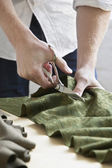 Tailor cutting fabric — Stock Photo