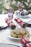Christmas crackers and mince pies — Stock Photo