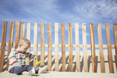 Boy playing with beach rake — Stock Photo