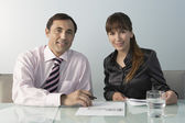 Businessman and woman sitting — Stock Photo