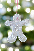 Gingerbread man hanging — Stock Photo