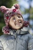 Girl  in winter clothes smiling — Stock Photo