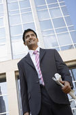 Smiling Businessman standing — Stock Photo