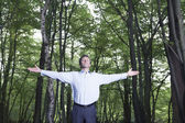 Man standing in forest — Stock Photo