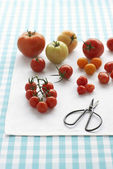 Assorted tomatoes on table — Stock Photo