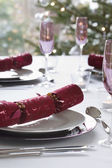 Christmas crackers on dining table — Stock Photo