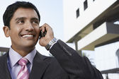 Businessman using mobile — Stock Photo
