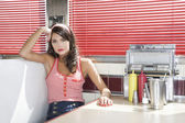 Woman in a Diner Booth — Stock Photo