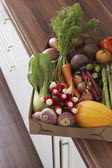 Fresh vegetables on kitchen counter — Stock Photo