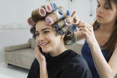Hairstylist Rolling Hair of Model — Stock Photo