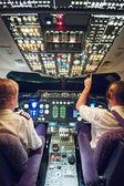 Pilots in aeroplane cockpit — Stock Photo