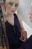 Girl looking in mirror — Stock Photo