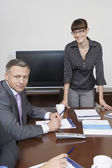 Businessman and woman at desk — Stock Photo