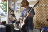 Boys playing drums and guitar — Stock Photo