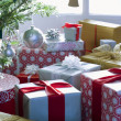 Stock Photo: Presents under Christmas tree