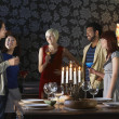 People standing by dining table — Stock Photo #33890721
